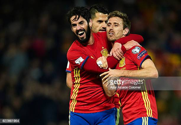 Nacho Monreal of Spain celebrates after scoring with his team mate Isco Alarcon of Spain during the FIFA 2018 World Cup Qualifier between Spain and...
