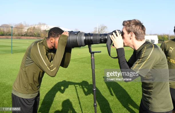 Nacho Monreal takes a picture of Ainsley Maitlandf-Niles before an Arsenal training session at London Colney on February 23, 2019 in St Albans,...