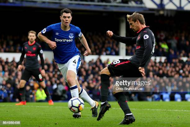 Nacho Montreal of Arsenal scores the equaliser during the Premier League match between Everton and Arsenal at Goodison Park on October 22, 2017 in...