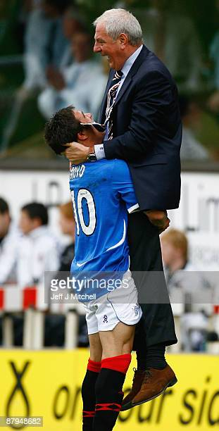 Nacho Novo lifts Walter Smith manager of Rangers as they celebrate winning the Scottish Premier League trophy after the Scottish Premier League match...