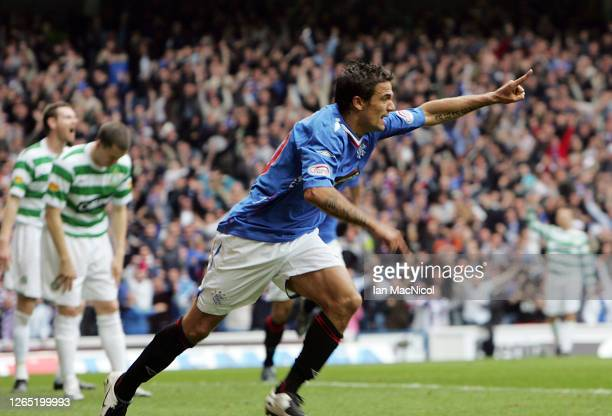 Nacho Novo of Rangers celebrates after scoring against Celtic during the Scottish Premier League match between Rangers and Celtic at Ibrox Stadium on...