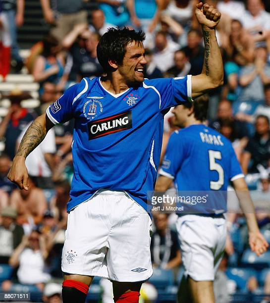 Nacho Novo of Rangers celebrates after scoring during the Scottish FA Cup Final match between Rangers and Falkirk at Hampden Park on May 30 2009 in...