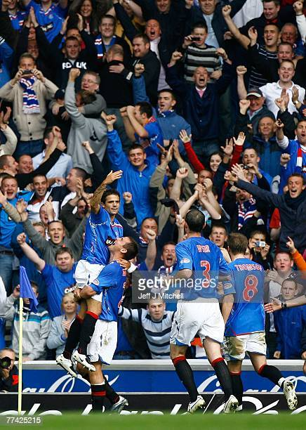 Nacho Novo of Rangers celebrates with Lee McCulloch after scoring his second goal against Celtic during the Scottish Premier League match between...