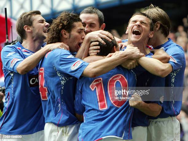 Nacho Novo of Rangers celebrates with Lee McCulloch after scoring against Celtic during the Scottish Premier League match between Rangers and Celtic...