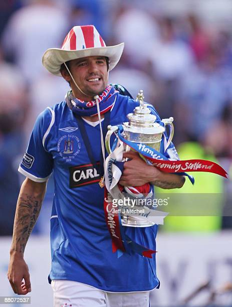 Nacho Novo of Rangers celebrates with the trophy after winning the Scottish FA Cup Final match against Falkirk at Hampden Park on May 30 2009 in...