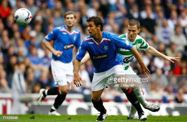 Nacho Novo of Rangers goes past Gary Caldwell of Celtic during the Scottish Premier League match between Rangers and Celtic at Ibrox Stadium on...