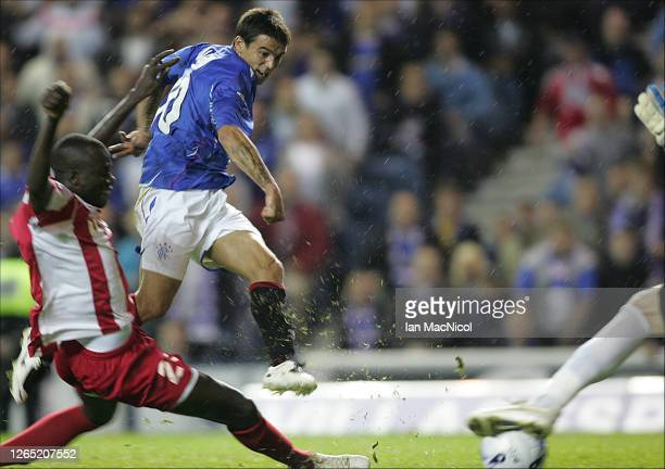 Nacho Novo of Rangers scores a last minute winner during the Uefa Champions league 3rd Round Qualifier match between Rangers and Red Star Belgrade at...