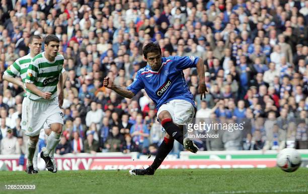 Nacho Novo of Rangers scores from the penalty spot against Celtic during the Scottish Premier League match between Rangers and Celtic at Ibrox...