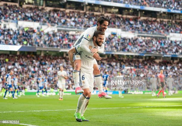 Nacho of Real Madrid celebrates with Isco Alarcon after scoring Real's 3rd goal during the La Liga match between Real Madrid CF and Deportivo Alaves...
