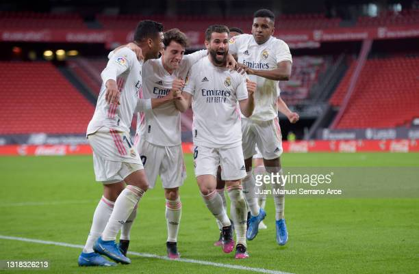Nacho of Real Madrid celebrates with team mates after scoring their side's first goal during the La Liga Santander match between Athletic Club and...