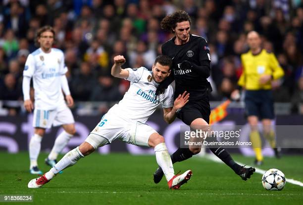 Nacho of Real Madrid competes for the ball with Adrien Rabiot of Paris SaintGermain during the UEFA Champions League Round of 16 First Leg match...
