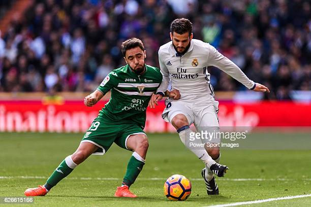 Nacho of Real Madrid competes for the ball with Unai Lopez of Deportivo Leganes during their La Liga match between Real Madrid and Deportivo Leganes...