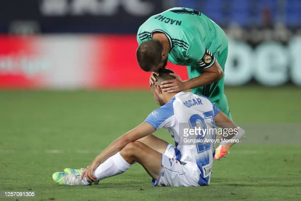Nacho of Real Madrid consoles Oscar Rodriguez of Leganes after the Liga match between CD Leganes and Real Madrid CF at Estadio Municipal de Butarque...