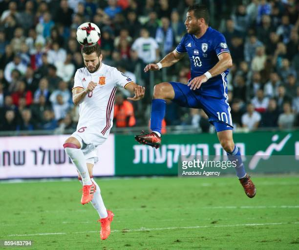 Nacho of Spain in action against Tomer Hemed of Israel during the 2018 FIFA World Cup European Group G qualifying football match between Israel and...