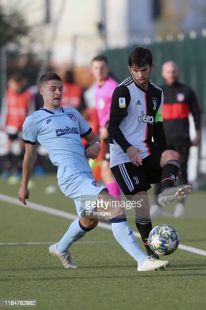 Nacho Quintana of Atletico Madrid U19 and Matteo Anzolin of Juventus Turin U19 battle for the ball during the UEFA Youth League match between...