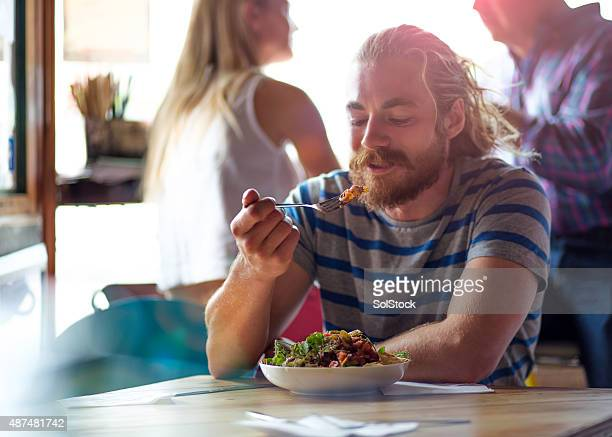 nacho time! - one mid adult man only stock pictures, royalty-free photos & images