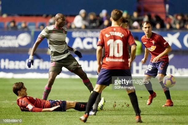 Nacho Vidal and Adrián Ramos are seen in action during the Spanish football of La Liga 123 match between CA Osasuna and Granada CF at the Sadar...