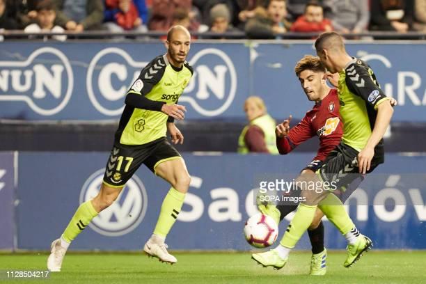 Nacho Vidal and Mikel are seen in action during the Spanish football of La Liga 123 match between CA Osasuna and Nastic of Tarragona at the Sadar...