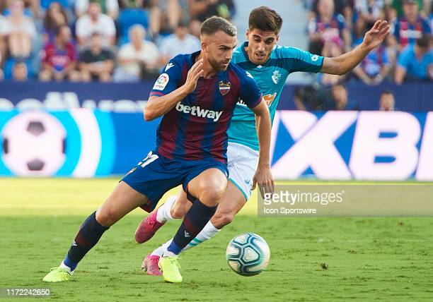 Nacho Vidal defender of CA Osasuna competes for the ball with Borja Mayoral forward of Levante UD during the La Liga match between Levante UD and...