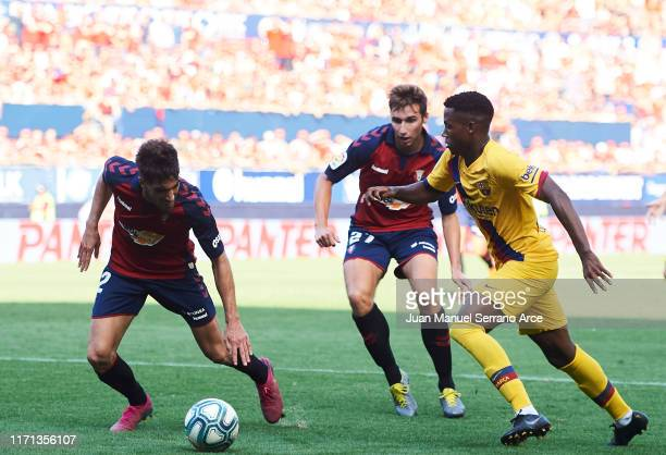 Nacho Vidal of CA Osasuna competes for the ball with Anssumane Fati of FC Barcelona during the Liga match between CA Osasuna and FC Barcelona at...