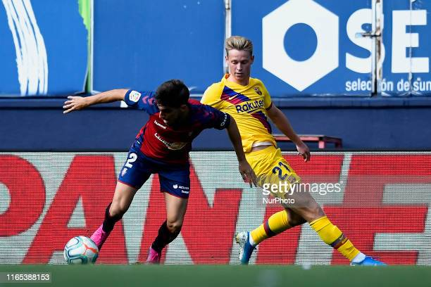 Nacho Vidal of Osasuna and Frenkie de Jong of Barcelona competes for the ball during the Liga match between CA Osasuna and FC Barcelona at on August...
