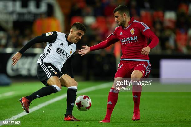 Nacho Vidal of Valencia CF competes for the ball with Alain of Real Zaragoza during the Copa del Rey round of 32 second leg match between Valencia CF...