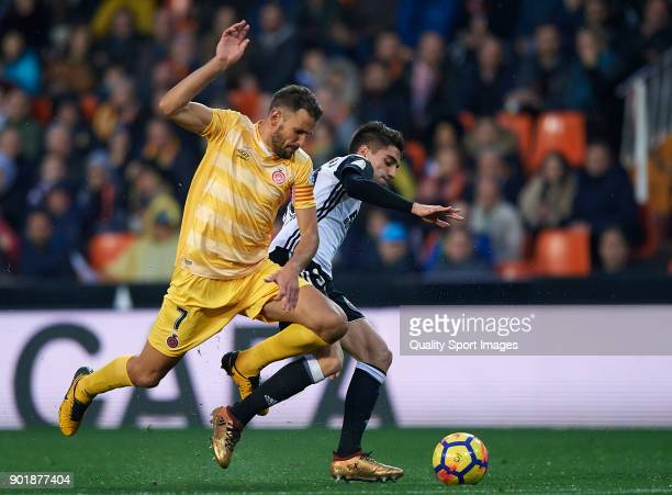 Nacho Vidal of Valencia competes for the ball with Christian Stuani of Girona during the La Liga match between Valencia and Girona at Mestalla...