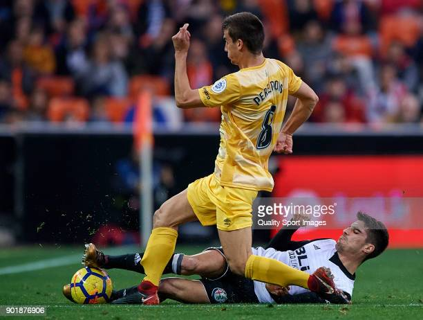 Nacho Vidal of Valencia competes for the ball with Pere Pons of Girona during the La Liga match between Valencia and Girona at Mestalla stadium on...