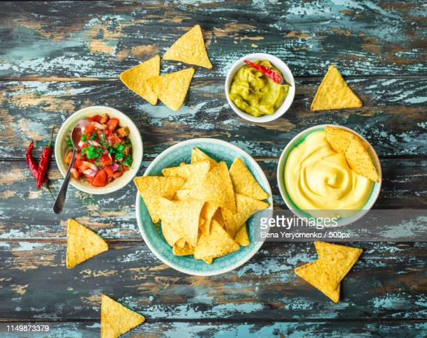 nachos and assorted dips - nachos stock pictures, royalty-free photos & images