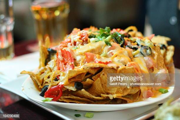 nachos and cheese - nachos stock photos and pictures