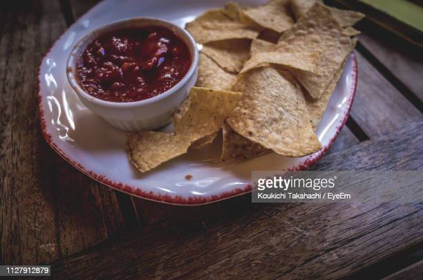 Nachos And Dip In Plate On Table