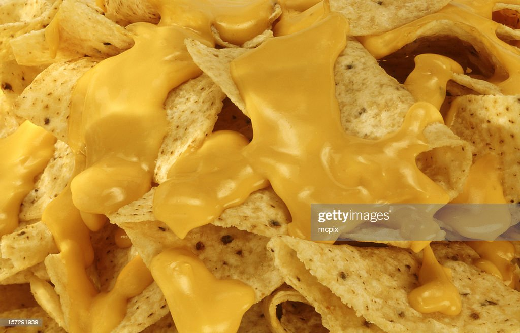 Nachos and Melted Cheese. : Stock Photo