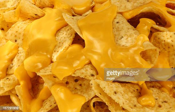 nachos and melted cheese. - cheese stock pictures, royalty-free photos & images