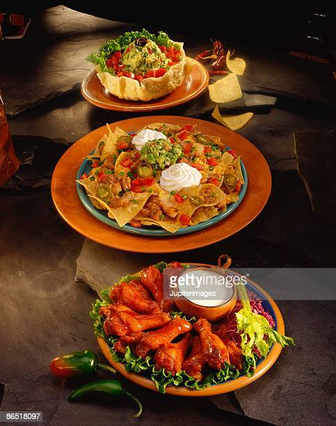 Nachos with buffalo chicken wings and tostadas