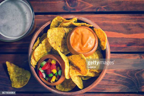 nachos with homemade sauces - cheese sauce stock photos and pictures