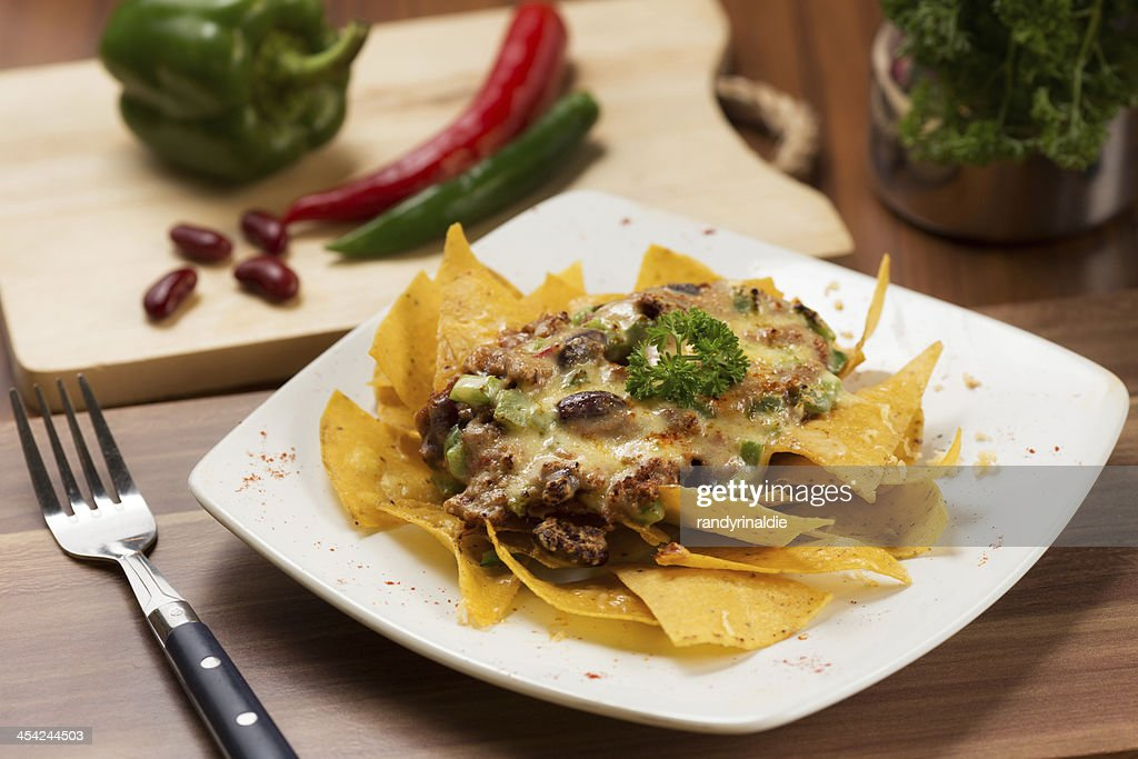 Nachos with Red Pea Sauce and Parsley : Stock Photo