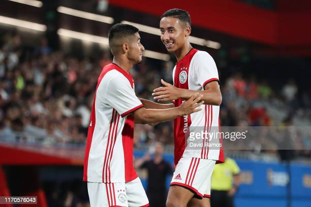 Naci Unuvar of Ajax U19 celebrates with his team mate Devyne Rensch after scoring his team's second goal past Ramon of FC Barcelona during their...