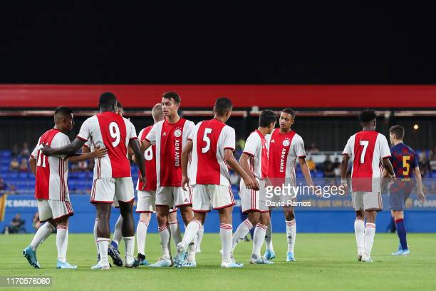 Naci Unuvar of Ajax U19 celebrates with his team mates after scoring his team's second goal past Ramon of FC Barcelona during their friendly match...