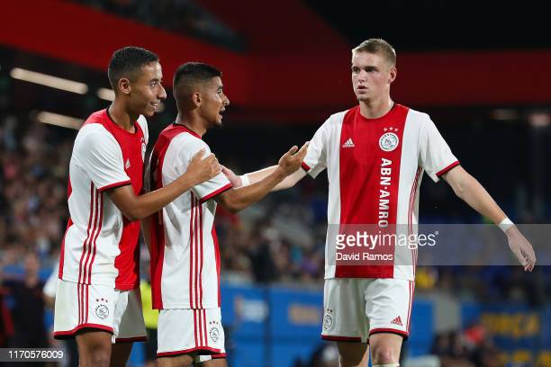 Naci Unuvar of Ajax U19 celebrates with his team mates Devyne Rensch and Kenneth Taylor after scoring his team's second goal past Ramon of FC...