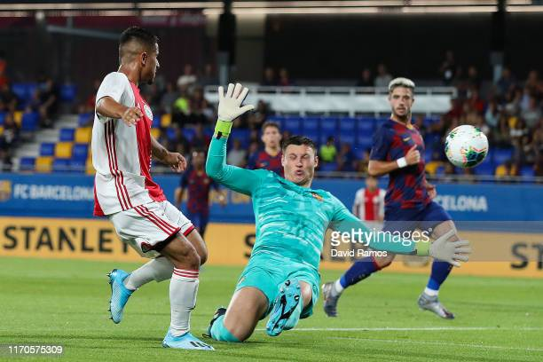 Naci Unuvar of Ajax U19 scores his team's second goal past Ramon of FC Barcelona during their friendly match between FC Barcelona U19 and Ajax U19 at...