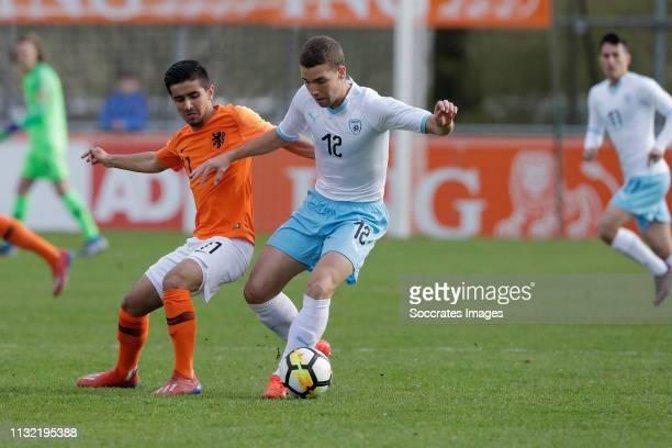Naci Unuvar of Holland U17 Aviel Yosef Zargary of Israel U17 during the match between Holland U17 v Israel U17 at the Sportpark Zegersloot on March...