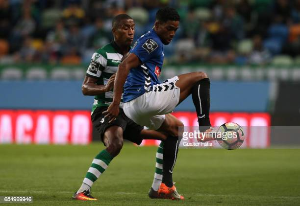 Nacional's forward Ricardo Gomes from Cape Verde with Sporting CP's defender Marvin Zeegelaar from Holland in action during the Primeira Liga match...
