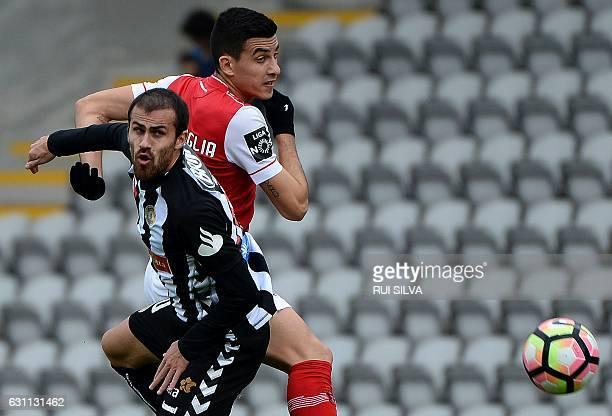 Nacional's midfielder Tiago Rodrigues vies with Sporting Braga's Argentinian midfielder Rodrigo Battaglia during the Portuguese league football match...