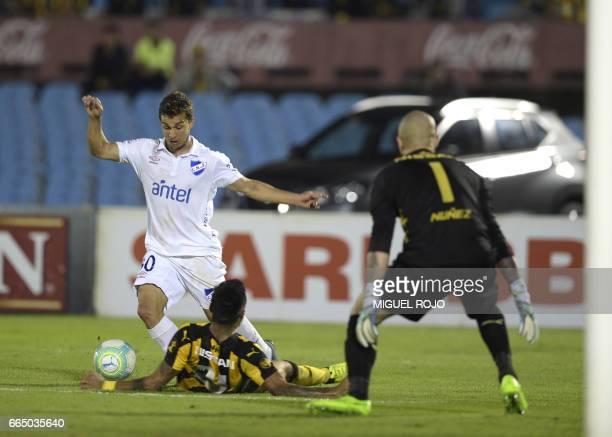 Nacional's Sebastian Fernandez vies for the ball with Penarol's Ramón Arias during the Uruguayan football derby at Centenario stadium in Montevideo...