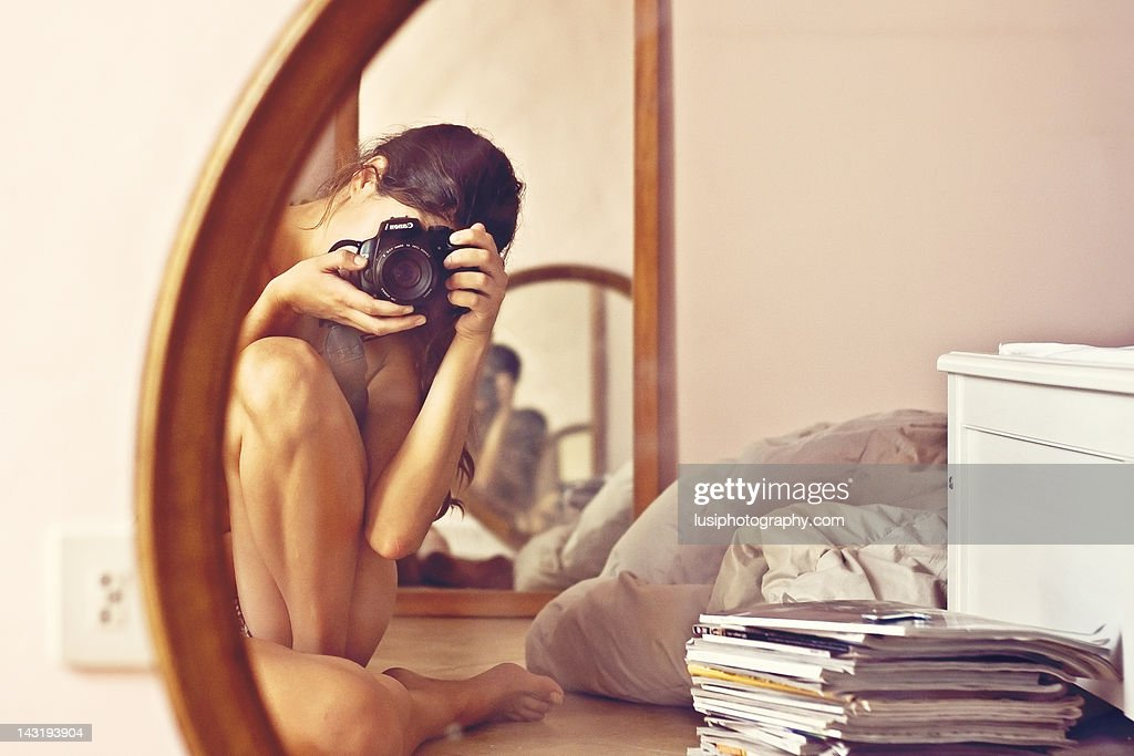 Nacked Woman Reflected In Bedrooms Mirrors Stock Photo