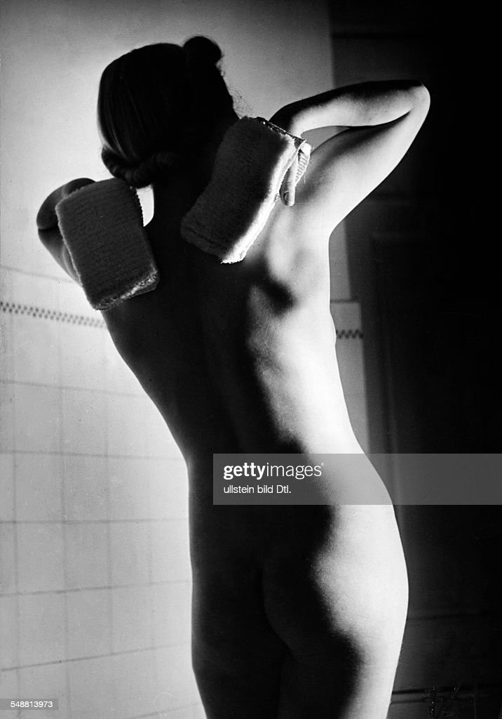 A Nacked Woman With Massage Gloves Half Length  Photographer Hedda Walther