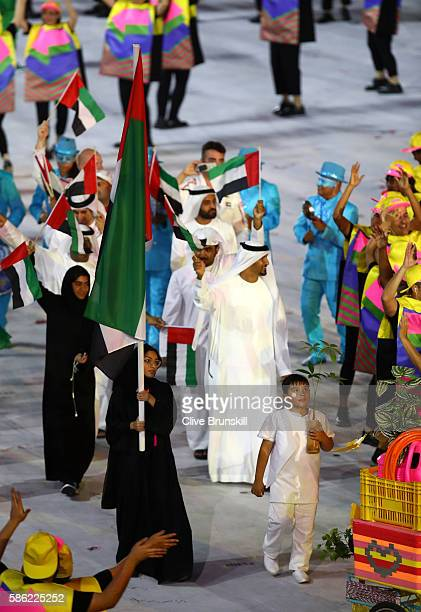 Nada Albedwawi of United Arab Emirates carries the flag during the Opening Ceremony of the Rio 2016 Olympic Games at Maracana Stadium on August 5...