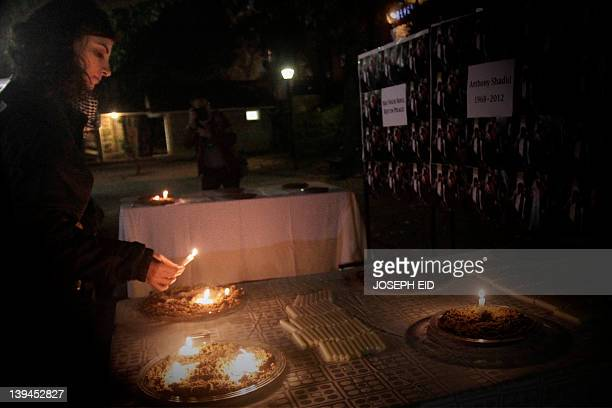 Nada Bakri the Lebanese wife of New York Times reporter Anthony Shadid who died last week in Syria of an asthma attack lights a candle at the end of...