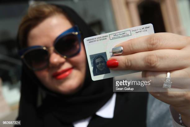 Nada Edlibi holds up her Saudi Arabian driver's license on the first day that she is legally allowed to drive in Saudi Arabia on June 24 2018 in...