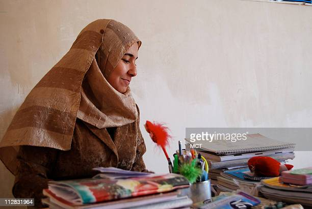 Nada Hatem Farhan sits at her desk in her bedroom in her family home in Fallujah Nada dreams of being a lawyer but will probably end up being a...